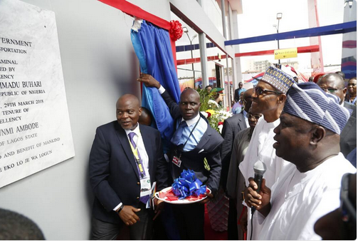 Buhari commissions Ikeja Bus Terminal, pats Ambode on the back for good job